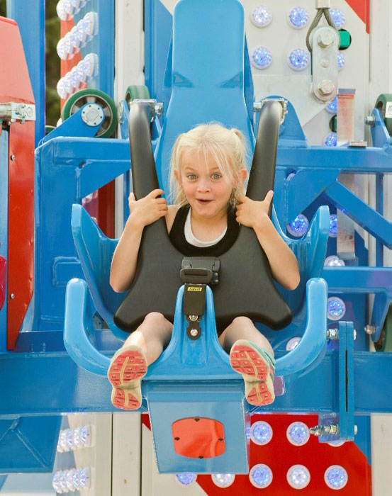 Young girl on amusement park ride