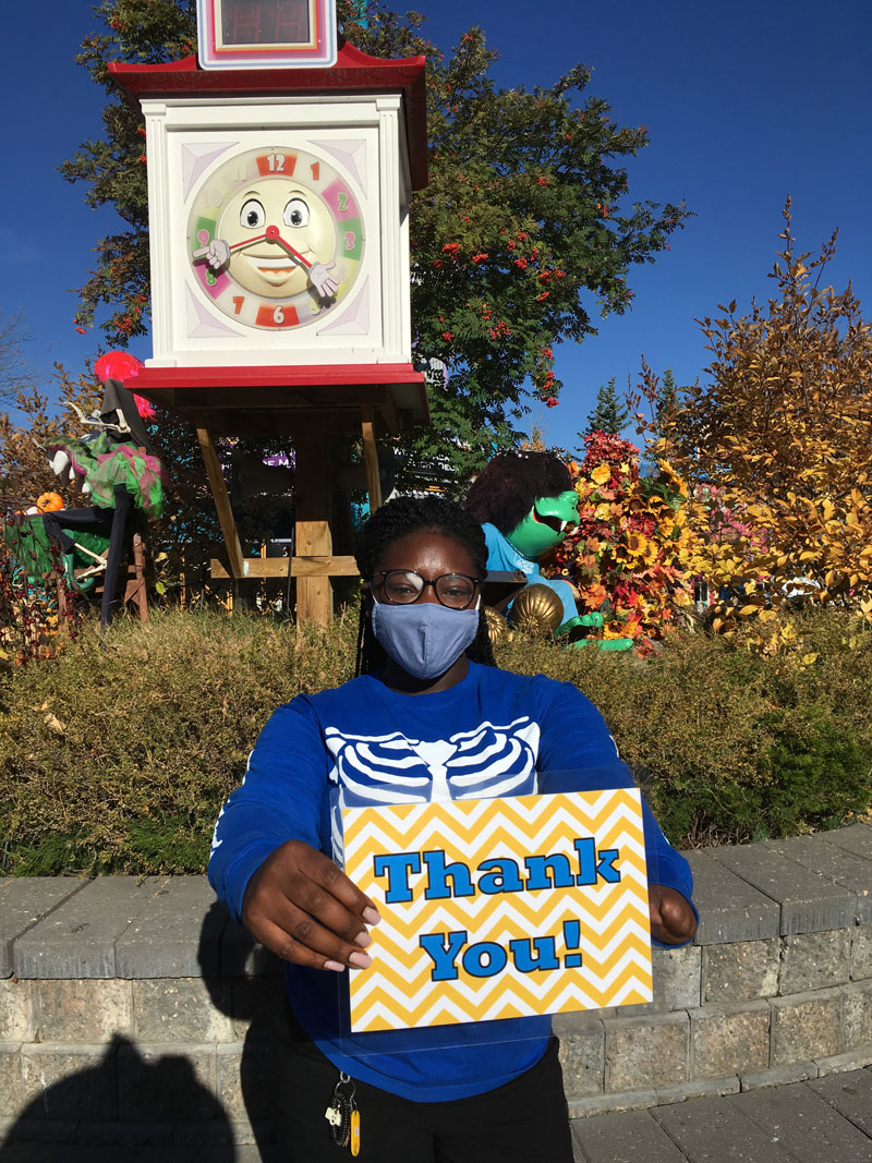 Calaway Park employee holding up a thank you sign