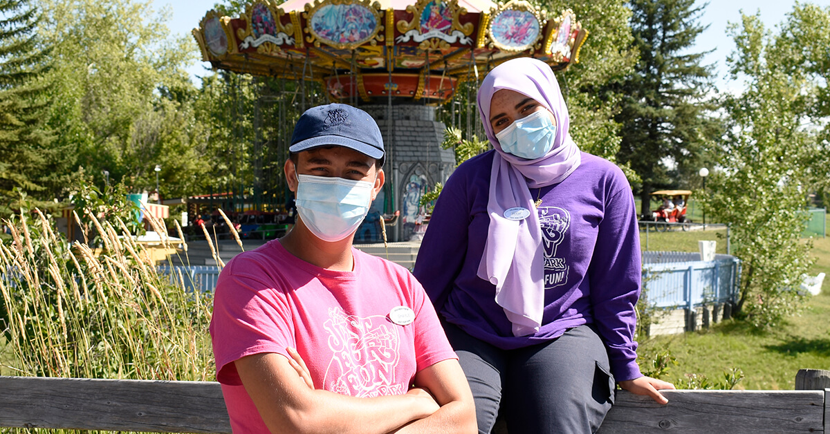 Two Calaway Park employees wearing masks